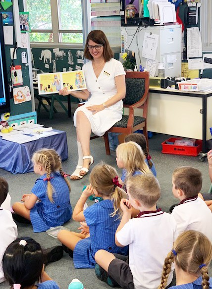 Kindy being read to