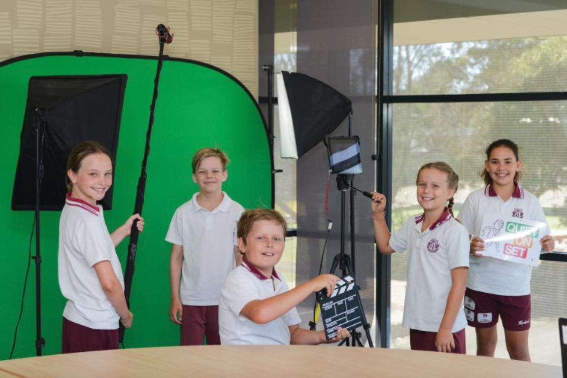 Students preparing book reviews using the green screen