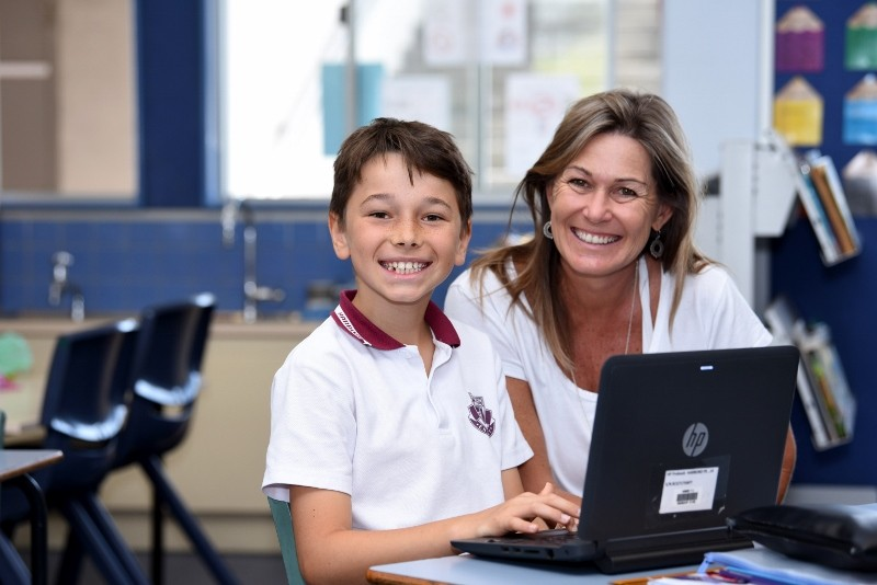 Student learning lessons on his laptop at Harboard Public School